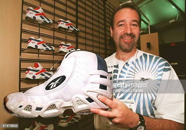 Reebok representative David Rogelson displays US basketball player Shaquille O'Neal's size 22 shoe 13 July at the Reebok Ring in Atlanta The 26th...