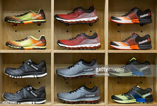 Reebok sneakers and running shoes produced by Reebok a unit of Adidas AG sit displayed for sale inside a sports trainer store in London UK on Monday...