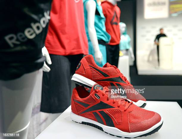 Reebokbranded clothes and footwear are seen on display during the Adidas AG earnings news conference in Herzogenaurach Germany on Thursday March 7...
