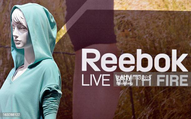 Reebokbranded clothes are displayed on a mannequin during the Adidas AG earnings news conference in Herzogenaurach Germany on Thursday March 7 2013...