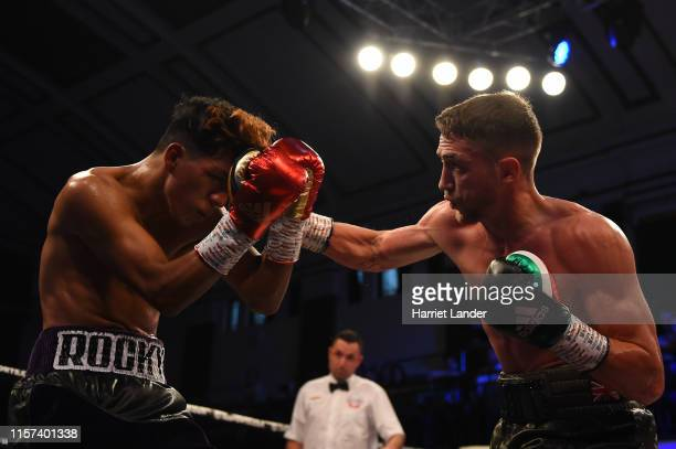 Reece Bellotti punches Josue Bendana during the Featherweight fight between Reece Bellotti and Josue Bendana at York Hall on June 21 2019 in London...