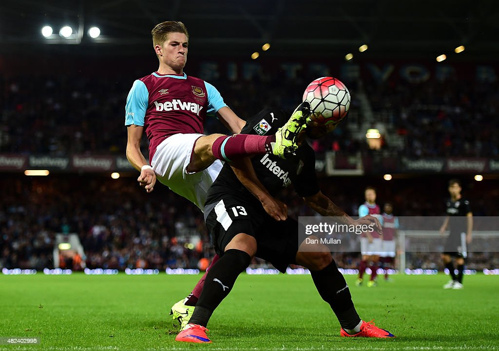 Reece Burke of West Ham (L) battles for the ball with Junior Morais of Astra Giurgiu during the UEFA Europa League third qualifying round match between West Ham United and Astra Giurgiu at the Boleyn Ground on July 30, 2015 in London, England.