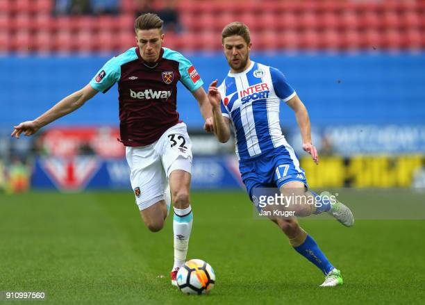 Reece Burke of West Ham United and Michael Jacobs of Wigan Athletic during The Emirates FA Cup Fourth Round match between Wigan Athletic and West Ham...