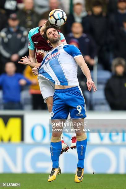 Reece Burke of West Ham United and Will Grigg of Wigan Athletic during the The Emirates FA Cup Fourth Round match between Wigan Athletic and West Ham...