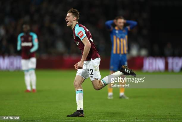Reece Burke of West Ham United celebrates scoring a goal to make the score 10 in extra time during the Emirates FA Cup Third Round Replay match...