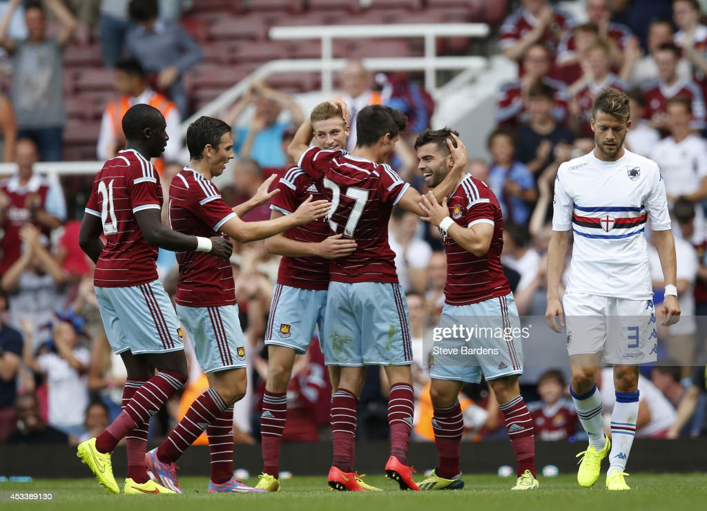 Reece Burke of West Ham United (3rd L) celebrates scoring the winning goal with his team mates during the pre-season friendly match between West Ham United and Sampdoria at Boleyn Ground on August 9, 2014 in London, England.