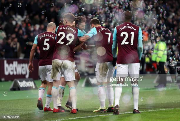 Reece Burke of West Ham United celebrates with his team mates after scoring a goal to make it 10 during the Emirates FA Cup Third Round Repaly match...