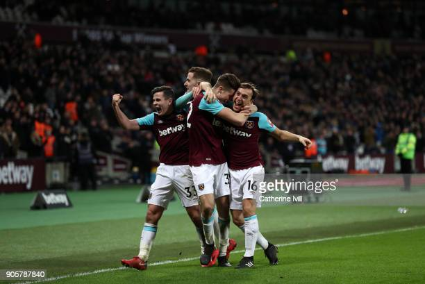 Reece Burke of West Ham United celebrates with team mates as he scores their first goal during the Emirates FA Cup Third Round Replay match between...