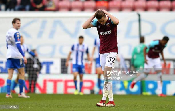 Reece Burke of West Ham United looks on dejected after seeing a shot at goal go wide during the Emirates FA Cup Fourth Round match between Wigan...