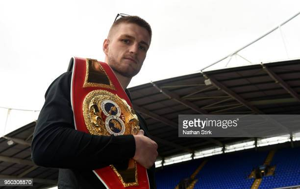 Reece Cartwright IBF youth middleweight world champion poses for a photograph during a press conference between Same Sexton and Hughie Furry at...