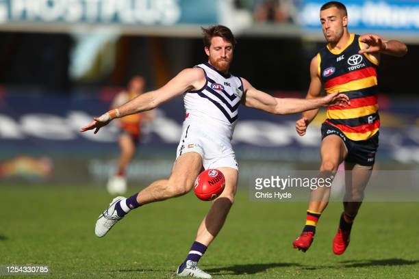 Reece Conca of the Dockers kicks during the round 5 AFL match between the Adelaide Crows and the Fremantle Dockers at Metricon Stadium on July 05,...