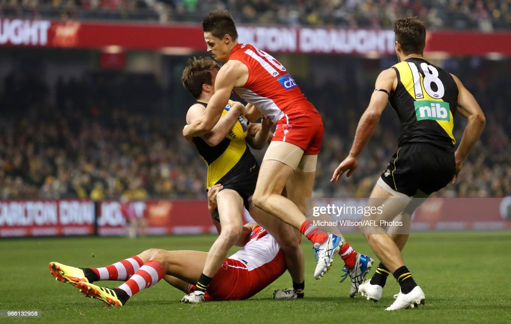 Reece Conca of the Tigers injures his ankle during the 2018 AFL round15 match between the Richmond Tigers and the Sydney Swans at Etihad Stadium on June 28, 2018 in Melbourne, Australia.