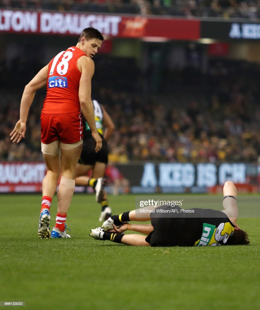 Reece Conca of the Tigers lays injured during the 2018 AFL round15 match between the Richmond Tigers and the Sydney Swans at Etihad Stadium on June 28, 2018 in Melbourne, Australia.