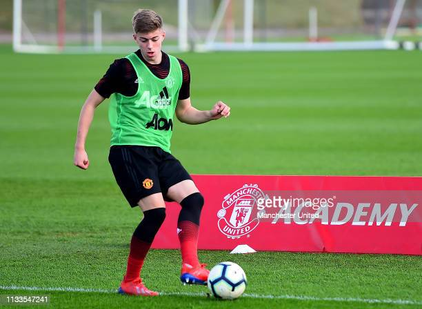 Reece Devine of Manchester United U18s warms up ahead of the U18 Premier League match between Manchester United U18s and West Bromwich Albion U18s at...