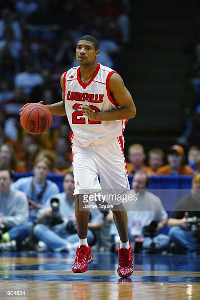 Reece Gaines of Louisville advances the ball against Butler during the NCAA Tournament on March 23 2003 at the Birmingham Civic Center in Birmingham...