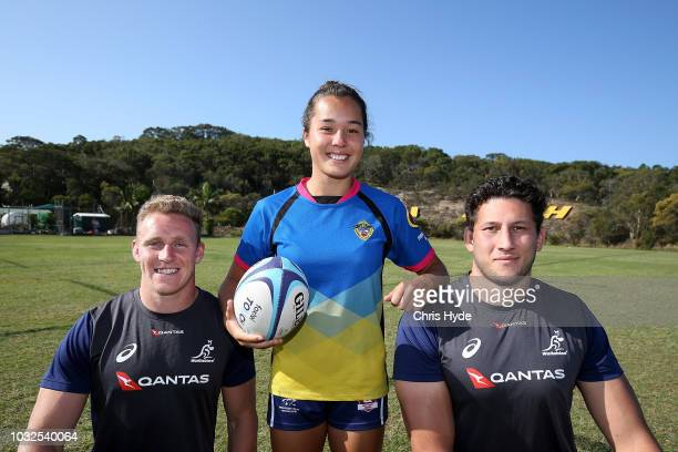 Reece Hodge and Adam Coleman pose Miami High School Rugby 7s player Lucy Single during an Australian Wallabies media opportunity on September 13 2018...