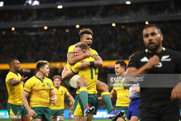 Reece Hodge of Australia celebrates his try with Will Genia during the 2019 Rugby Championship Test Match between the Australian Wallabies and the...