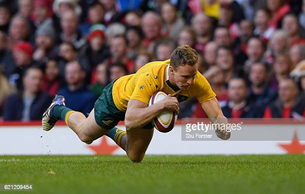 Reece Hodge of Australia dives over to score his team's second try during the international match between Wales and Australia at the Principality...