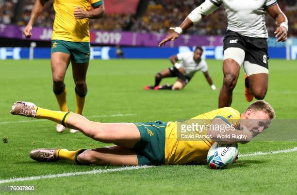 Reece Hodge of Australia dives to score his side's second try during the Rugby World Cup 2019 Group D game between Australia and Fiji at Sapporo Dome...