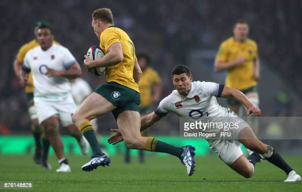 Reece Hodge of Australia is tackled by Ben Youngs during the Old Mutual Wealth Series international match between England and Australia at Twickenham...