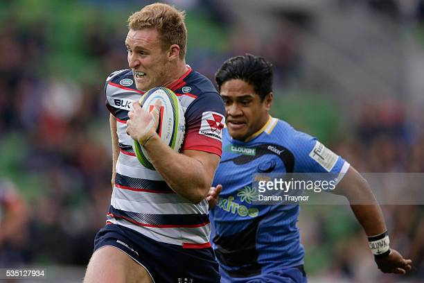 Reece Hodge of the Rebels breaks through for a try during the round 14 Super Rugby match between the Rebels and the Force at AAMI Park on May 29 2016...