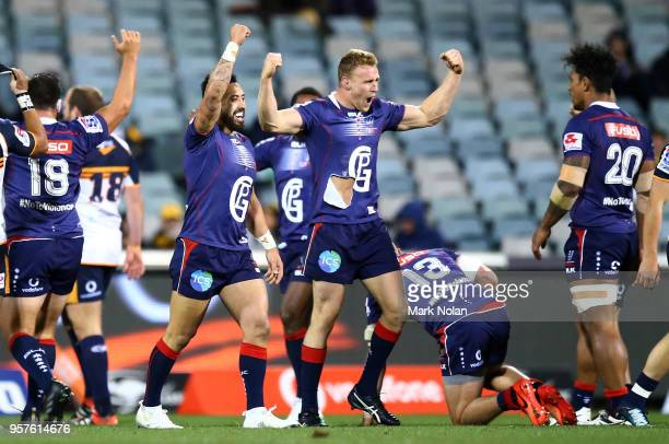 Reece Hodge of the Rebels celebrates with team mates after winning the round 12 Super Rugby match between the Brumbies and the Rebels at GIO Stadium...