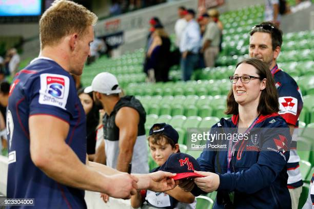 Reece Hodge of the Rebels greets fans after the round two Super Rugby match between the Melbourne Rebels and the Queensland Reds at AAMI Park on...