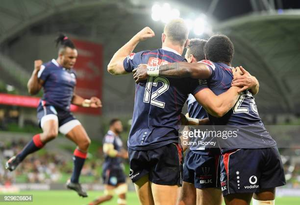 Reece Hodge of the Rebels is congratulated by team mates after scoring a try during the round four Super Rugby match between the Rebels and the...