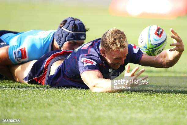 Reece Hodge of the Rebels loses the ball while attempting to score a try during the round five Super Rugby match between the Waratahs and the Rebels...