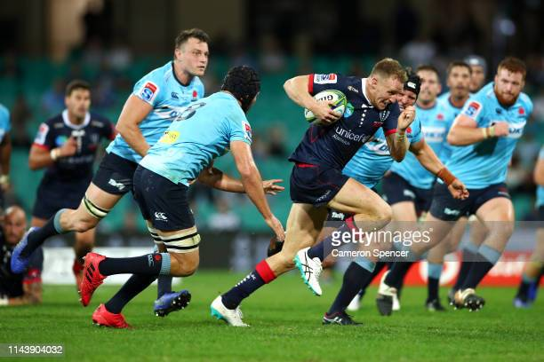 Reece Hodge of the Rebels makes a break during the round 10 Super Rugby match between the Waratahs and the Melbourne Rebels at the Sydney Cricket...