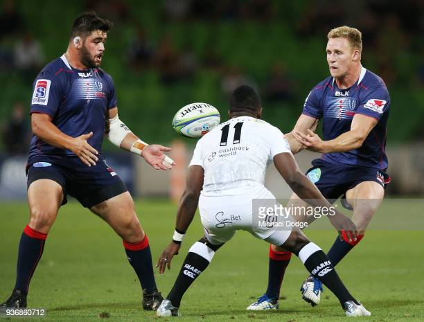Reece Hodge of the Rebels passes the ball Rebelsduring the round six Super Rugby match between the Melbourne Rebels and the Sharks at AAMI Park on...