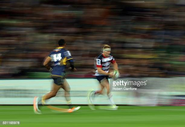 Reece Hodge of the Rebels runs with the ball during the round 12 Super Rugby match between the Rebels and the Brumbies at AAMI Park on May 13 2016 in...