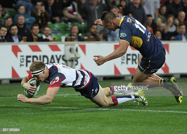 Reece Hodge of the Rebels scores a try during the round 12 Super Rugby match between the Rebels and the Brumbies at AAMI Park on May 13 2016 in...