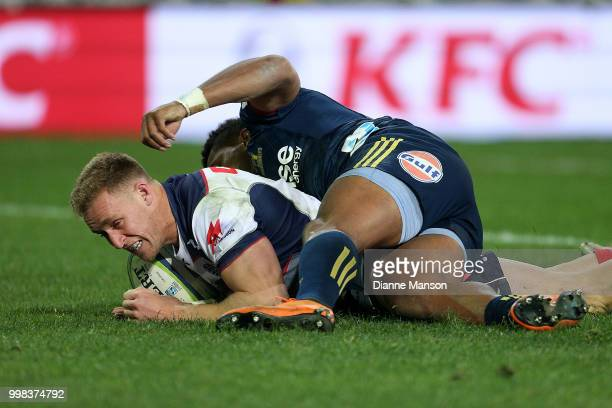 Reece Hodge of the Rebels scores a try during the round 19 Super Rugby match between the Highlanders and the Rebels at Forsyth Barr Stadium on July...