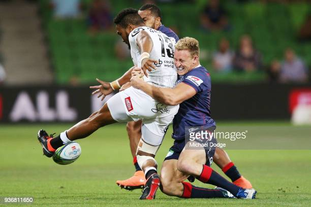 Reece Hodge of the Rebels tackles Lukhanyo Am of the Sharks during the round six Super Rugby match between the Melbourne Rebels and the Sharks at...