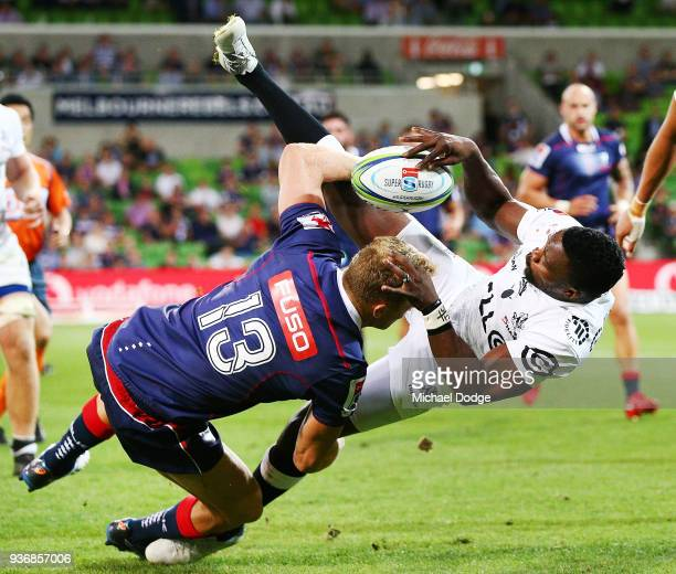 Reece Hodge of the Rebels tackles S'busiso Nkosi of the Sharks during the round six Super Rugby match between the Melbourne Rebels and the Sharks at...