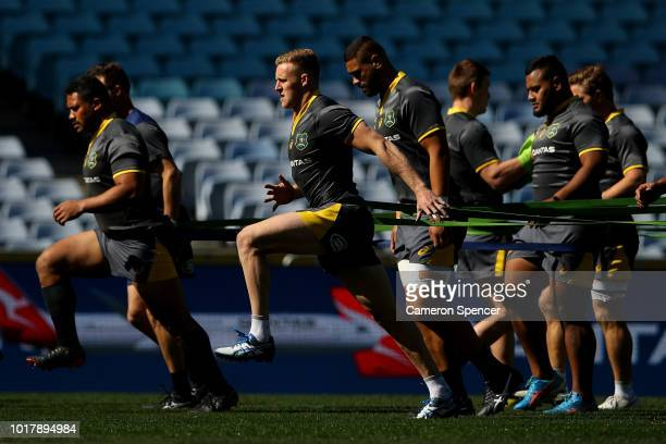 Reece Hodge of the Wallabies and team mates warm up during an Australian Wallabies captain's run at ANZ Stadium on August 17 2018 in Sydney Australia