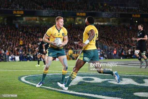 Reece Hodge of the Wallabies celebrates after scoring a try during The Rugby Championship game between the New Zealand All Blacks and the Australia...