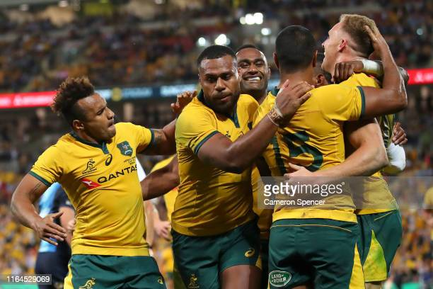 Reece Hodge of the Wallabies celebrates scoring a try with team mates during the 2019 Rugby Championship Test Match between Australia and Argentina...