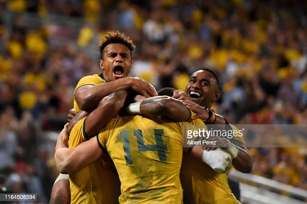 Reece Hodge of the Wallabies celebrates with team mates after scoring a try during the 2019 Rugby Championship Test Match between Australia and...