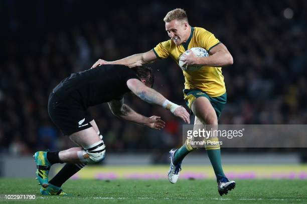 Reece Hodge of the Wallabies makes a break during The Rugby Championship game between the New Zealand All Blacks and the Australia Wallabies at Eden...