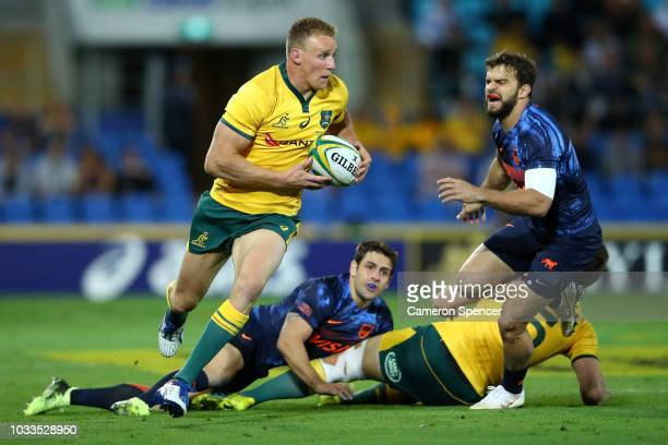 Reece Hodge of the Wallabies makes a break during The Rugby Championship match between the Australian Wallabies and Argentina Pumas at Cbus Super...