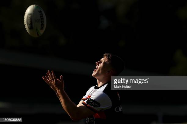 Reece Hoffman catches a kick during a Wests Tigers NRL training session at St Luke's Parrk North on March 09, 2021 in Sydney, Australia.