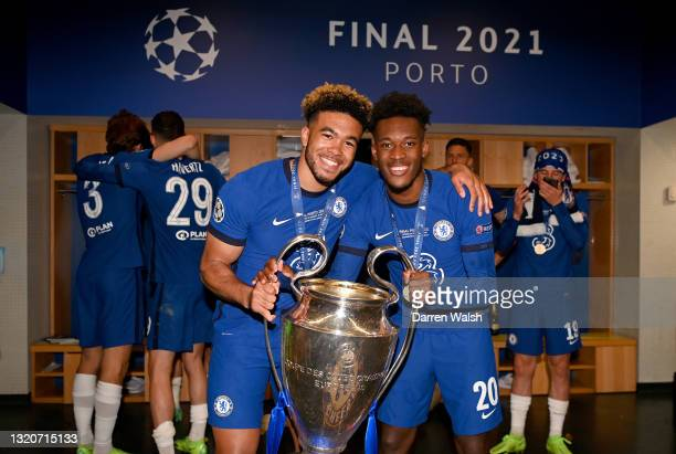 Reece James and Callum Hudson-Odoi of Chelsea celebrate in the dressing room with the Champions League Trophy following their team's victory during...