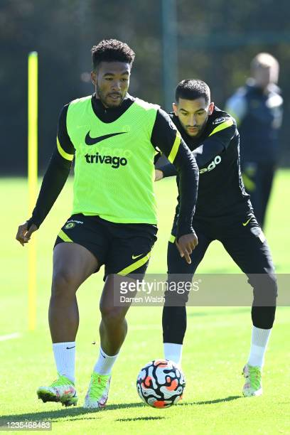 Reece James and Hakim Ziyech of Chelsea during a training session at Chelsea Training Ground on September 24, 2021 in Cobham, England.