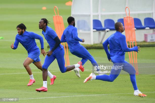 Reece James and Tammy Abraham of Chelsea during a training session at Chelsea Training Ground on June 4, 2020 in Cobham, England.