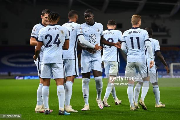 Reece James celebrates with teammates after scoring his sides second goal during the Premier League match between Brighton Hove Albion and Chelsea at...