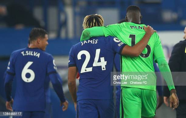 Reece James of Chelsea and Edouard Mendy of Chelsea hug after the match during the Premier League match between Chelsea and Sheffield United at...