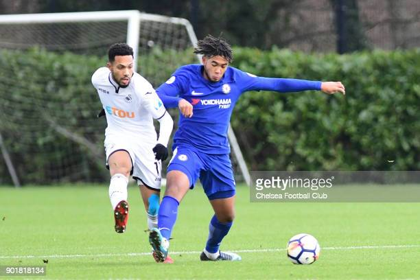 Reece James of Chelsea and Kenji Gorre of Swansea during the Premier League 2 match between Swansea and Chelsea at Landore Training Centre on January...