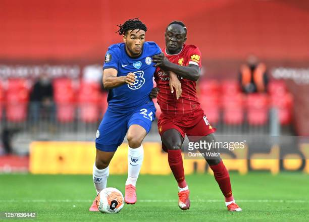 Reece James of Chelsea and Sadio Mane of Liverpool battle for the ball during the Premier League match between Liverpool FC and Chelsea FC at Anfield...